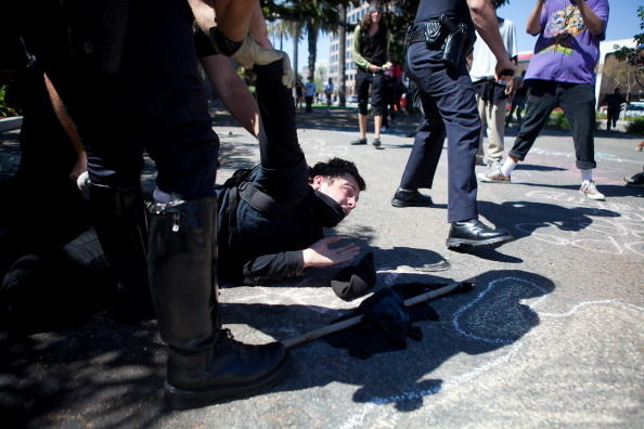 A protester is taken into custody by Orange County Police Officers during a demonstration to show outrage for the several recent officer involved shootings on July 29, 2012 in Anaheim, California. For the past week, protesters have clashed with police resulting in both property damage and many arrests.
