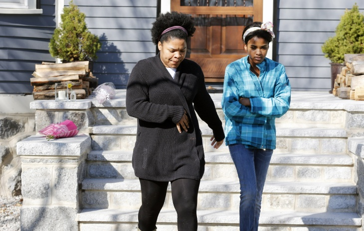 Two women leave after placing flowers on the doorstep of the Richard house in the Dorchester neighborhood of Boston, Tuesday, April 16, 2013. Martin Richard, 8, was killed in Monday's bombings at the finish line of the Boston Marathon. The boy's mother, Denise, and 6-year-old sister, Jane, were badly injured.