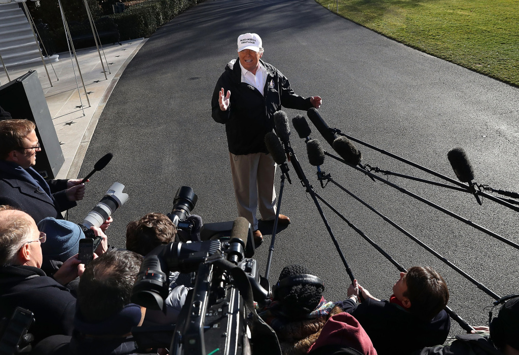 U.S. President Donald Trump speaks to the media before departing on Marine One from the White House on January 10, 2019 in Washington, DC