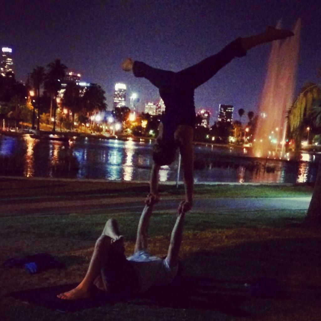 KPCC's Rebecca Plevin performs acro-yoga.