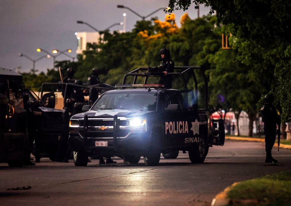 Mexican police patrol in a street of Culiacan, state of Sinaloa, Mexico, on October 17, 2019, after heavily armed gunmen in four-by-four trucks fought an intense battle with Mexican security forces.