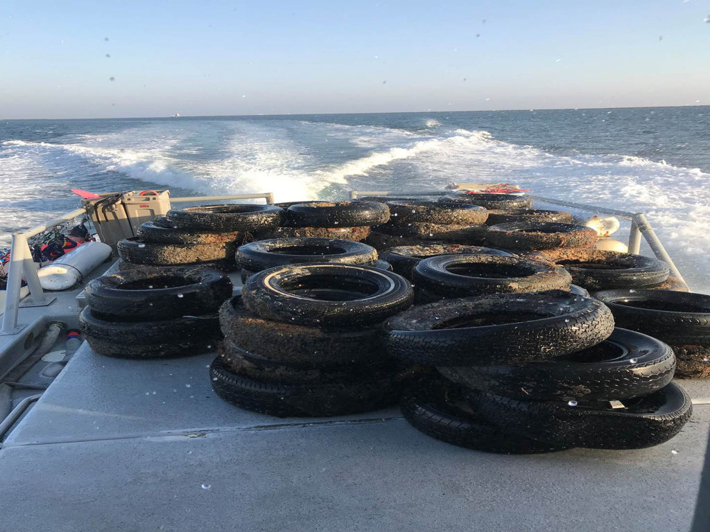 This Oct. 12, 2017 photo shows a pile of scrap tires after they were pulled out of the water off Balboa Peninsula in Newport Beach, California.