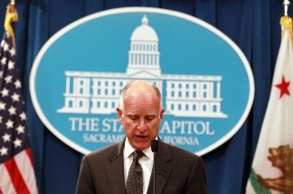 California Governor Jerry Brown announced a balanced state budget that cuts spending by $12.5 billion and includes an eight to ten percent cut in take home pay for state employees and proposes a 'vast and historic' restructuring of government operations