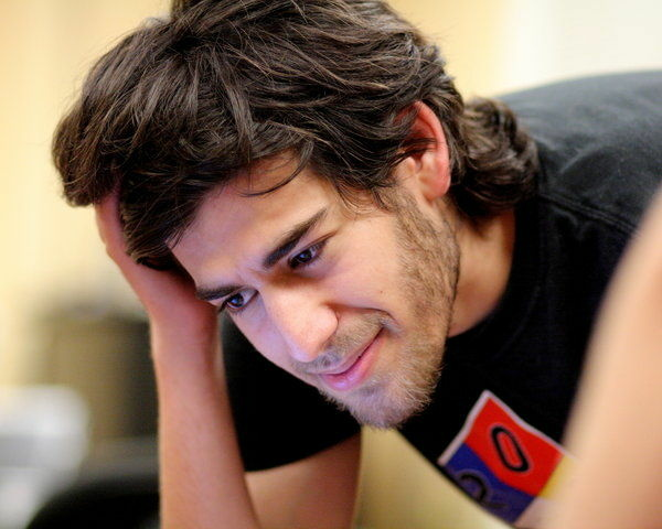 In this Jan. 30, 2009 photo, Internet activist Aaron Swartz poses for a photo in Miami Beach, Fla. Swartz was found dead Friday, Jan. 11, 2013, in his Brooklyn, N.Y., apartment, according to Ellen Borakove, spokeswoman for New York's medical examiner. Swartz, 26, was scheduled to face trial on hacking charges in a few weeks.