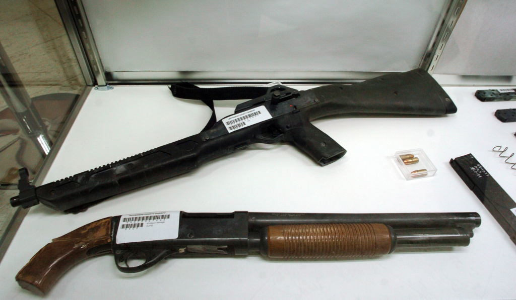 A pump action shotgun and assault rifle used in the 1999 Columbine High School shooting are shown on display at the Jefferson County Fairgrounds February 26, 2004 in Golden, Colorado. Columbine students Eric Harris and Dylan Klebold killed 13 people at Columbine High School April 20, 1999 in Littleton, Colorado in the worst school shooting in U.S. history.