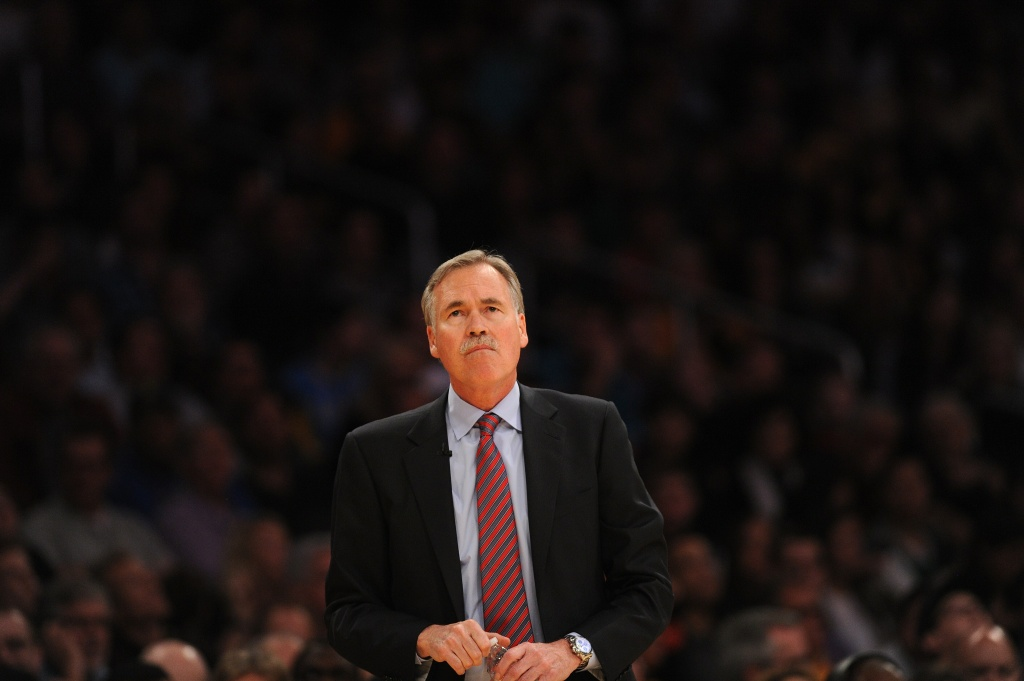 Los Angeles Lakers coach Mike D'Antoni watches from the sidelines during the NBA game between the Lakers and the Boston Celtics NBA, February 21, 2014 at Staples Center in Los Angeles, California.