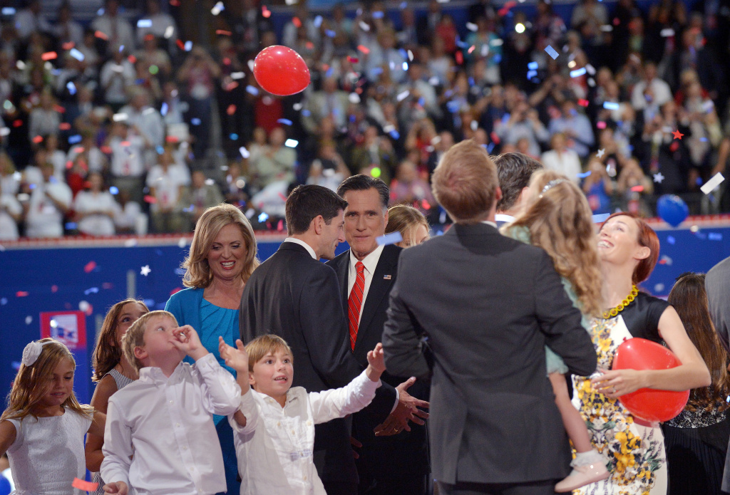 Republican presidential candidate Mitt Romney (C), his wife Ann (L) and running mate Paul Ryan are surrounded by their family members following Romney's address at the Republican National Convention (RNC) at the Tampa Bay Times Forum in Tampa, Florida, on August 30, 2012.