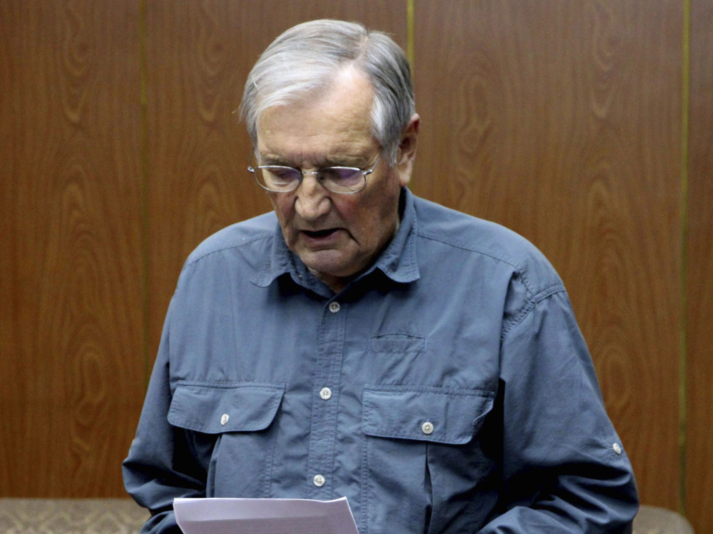 A Nov. 9, 2013 file photo released by KCNA of U.S. citizen Merrill Newman reportedly reading an apology.