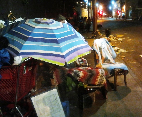 A homeless person's belongings are seen blocking a pedestrian walkway in Downtown Los Angeles.