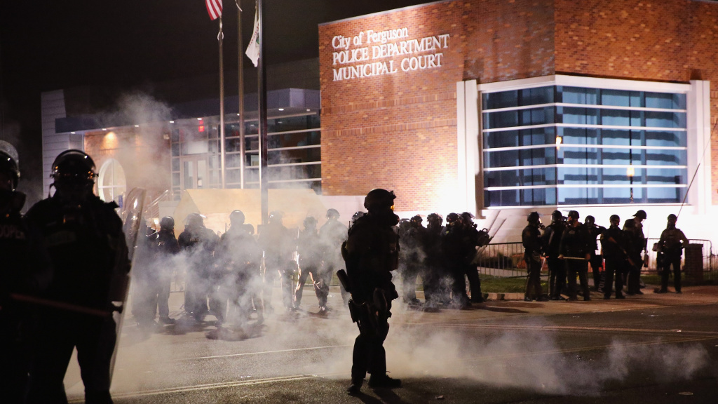 Police guarding the Ferguson Police Department during violent protests following the grand jury announcement in the Michael Brown case in November.