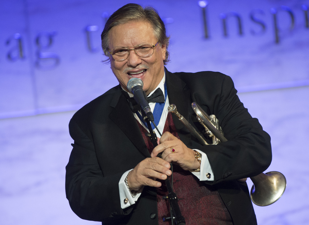 Jazz musician Arturo Sandoval performs during a dinner for Medal of Freedom awardees at the Smithsonian National Museum of American History on November 20, 2013.