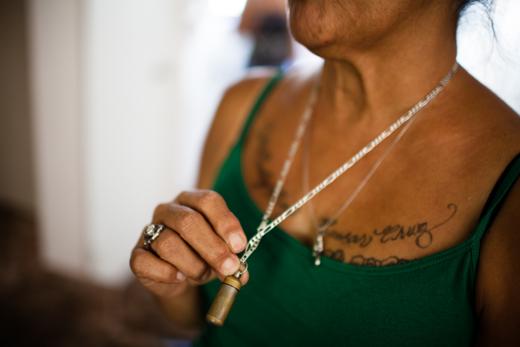 Smith carries some of the ashes of her son, Caesar Cruz, around her neck. Cruz was shot and killed by Anaheim police in 2009.