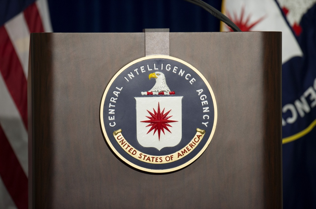 The lectern stands empty as reporters await the arrival of Director of Central Intelligence Agency John Brennan for a press conference at CIA headquarters in Langley, Virginia, December 11, 2014.
