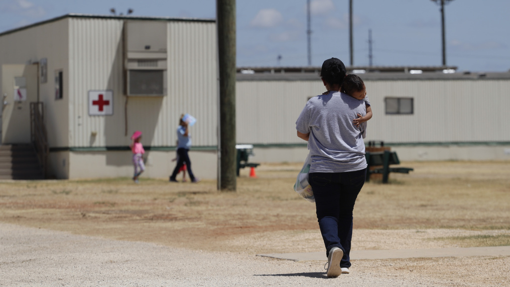 Immigrants seeking asylum are seen last year at the ICE South Texas Family Residential Center in Dilley, Texas. A federal judge on Wednesday ordered the Trump administration to stop expelling immigrant children who cross the southern border alone as an anti-coronavirus measure.