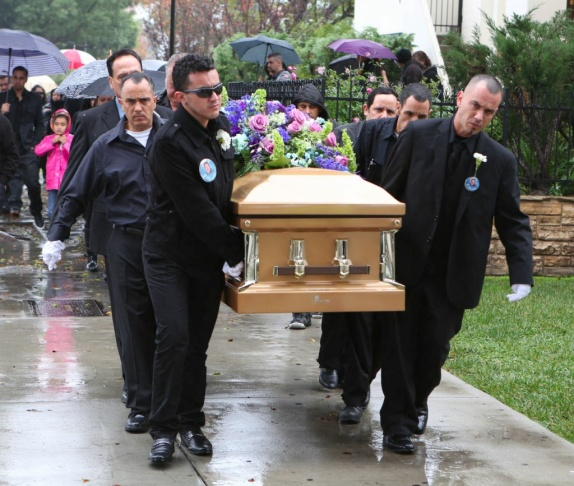 Pall bearers carry the casket of Luis Valadez.