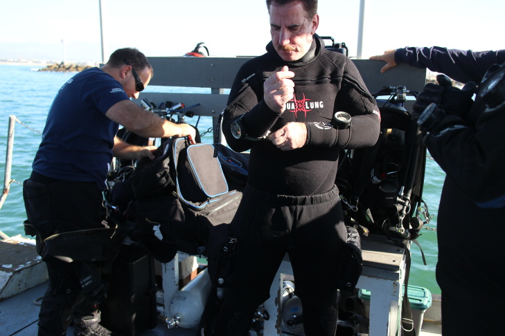 A volunteer diver for the Ocean Defenders Alliance holds gear recovered from the sea floor.