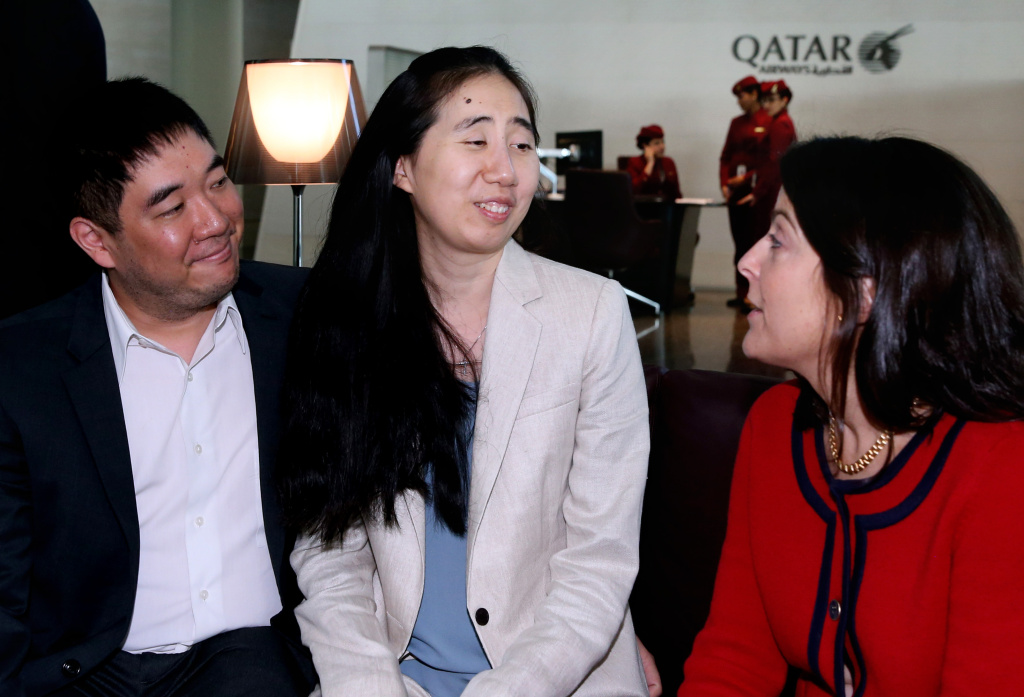 File: American couple Grace, center, and Matthew Huang, left, speak with U.S. Ambassador to Qatar, Dana Shell Smith, right, at the Hamad International Airport in Doha, Qatar, Wednesday, Dec. 3, 2014. The couple has arrived in Los Angeles after being cleared in the death of their adopted 8-year-old daughter in Qatar.