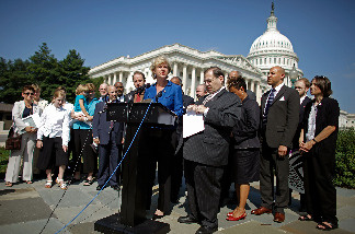Rep. Tammy Baldwin (D-WI) (C) delivers remarks about legislation to repeal the Defense of Marriage Act during a news conference with other members of Congress and married same-sex couples at the U.S. Captiol September 15, 2009 in Washington, DC.
