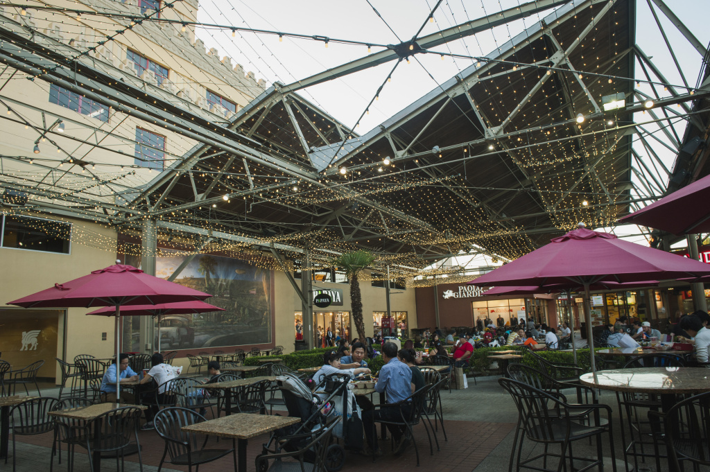 The original steel roof beams from the tire and rubber factory that later became the Citadel Outlets are still visible above the mall's food court in Commerce, California.
