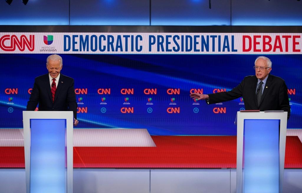 Democratic presidential hopefuls former US vice president Joe Biden and Senator Bernie Sanders take part in the 11th Democratic Party 2020 presidential debate in a CNN Washington Bureau studio in Washington, DC on March 15, 2020.