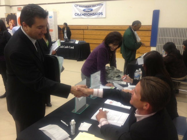 Charles Downey of Orange County makes his job pitch to a rep from the Irvine Company at a job fair in Fountain Valley, Wednesday, April 11, 2012.