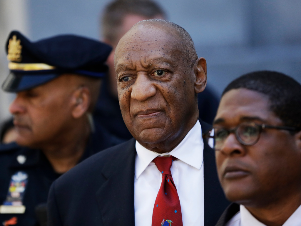 Bill Cosby, center, leaves the the Montgomery County Courthouse in Pennsylvania after being convicted of drugging and molesting a woman on April 26, 2018.