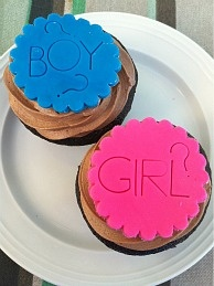 Fauxstess cupcakes filled with creme dyed with color to match the gender of the baby.