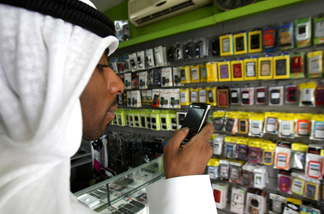 A man looks at a BlackBerry mobile phone in a store in Dubai on August 01, 2010, as the Gulf business hub stated it will suspend key BlackBerry services from October because they are incompatible with local laws and raise security concerns.