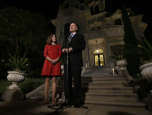Gov. Jerry Brown, accompanied by his wife, Anne Gust Brown, smiles as he talks to reporters outside the Old Governors Mansion State Historic Park after winning re-election  Tuesday, Nov. 4, 2014.   Brown defeated Republican challenger Neel Kashari to  becomes the first person to be elected governor four times.(AP Photo/Rich Pedroncelli)