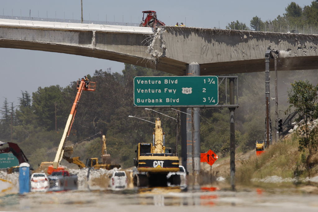 File: Workers demolish the south side of Mulholland overpass on the 405 freeway during the 53-hour total freeway closure dubbed