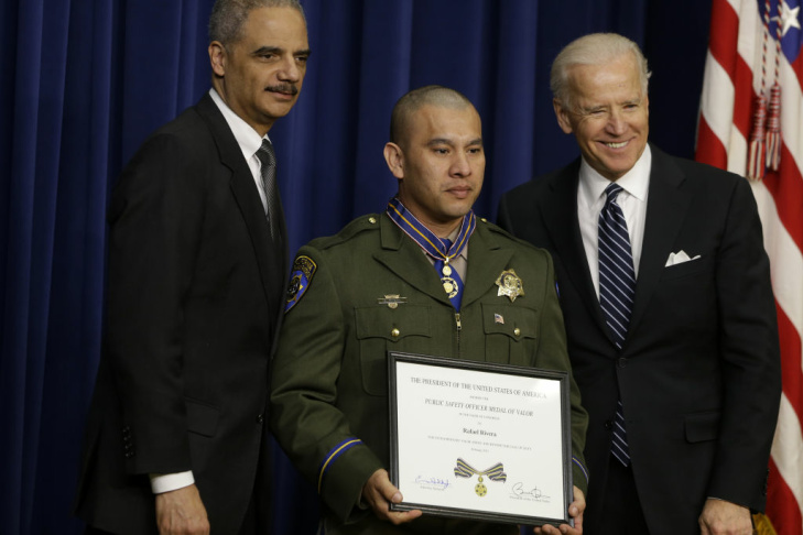 Vice President Joe Biden and Attorney General Eric Holder present the Medal of Valor to Officer Rafael Rivera of the California Highway Patrol, Wednesday, Feb. 20, 2013, during a ceremony in the Eisenhower Executive Office Building on the White House complex in Washington. The medal is the highest national award for valor by a public safety officer. The medal is awarded to public safety officers who have exhibited exceptional courage, regardless of personal safety, in the attempt to save or protect human life.