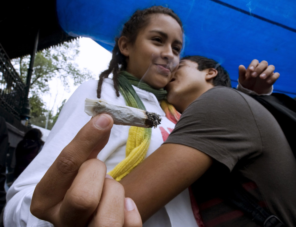 A couple dances and smokes a joint during a rally for the legalization of marijuana in Mexico City, on September 5, 2010.