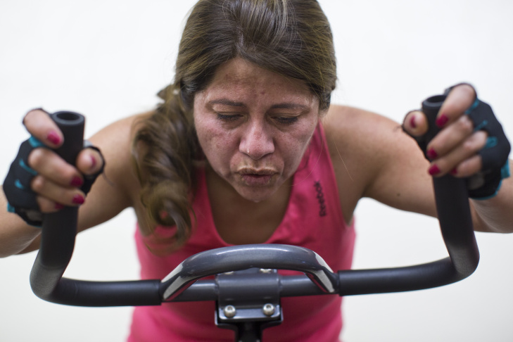 Client Mercedes Pedroza works out at Extreme Workout Team in Huntington Park on Tuesday morning, Nov. 18, 2014. Funding help for the fitness studio came from Grameen, an international micro-loan foundation.