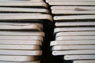 A stack of grading books.