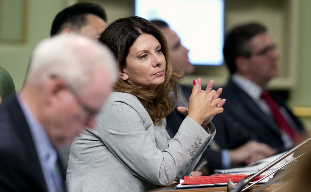 In this Aug. 21, 2017, file photo, Assemblywoman Melissa Melendez, R-Lake Elsinore, sits at the Capitol in Sacramento, Calif. For four years in a row, Melendez has authored a bill to enshrine whistleblower protections into law for those legislative staff members who come forward with allegations of sexual assault and harassment, only to have the bills killed in the Senate Appropriations Committee.
