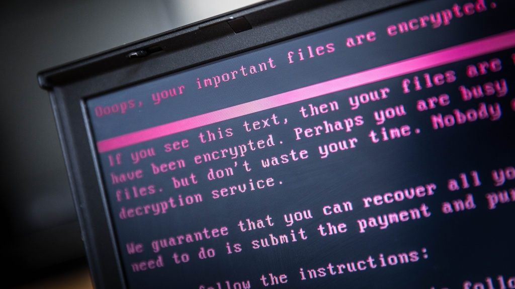 A laptop displays a message after being infected by ransomware in 2017. Thousands of institutions  in the U.S. fall victim to ransomware attacks each year.