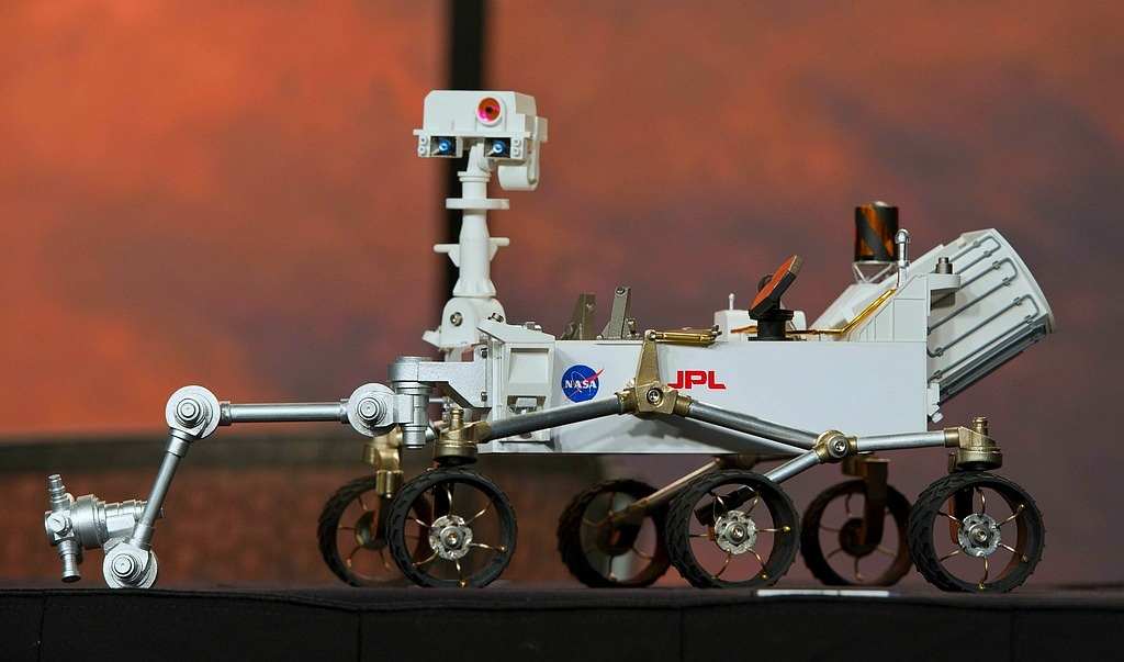 A model of the Curiosity, NASA's most advanced mobile robotic laboratory, which will examine one of the most intriguing areas on Mars, is seen prior to a news briefing, Thursday, Nov. 10, 2011, at NASA Headquarters in Washington D.C.
