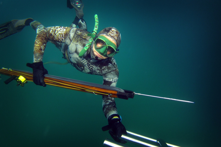 Dr. Joe Farlo spearfishes near Redondo Beach on Wednesday, Aug. 14. Spearfishing got popular in the early 20th century after the invention of goggles, and the development of frogmen.