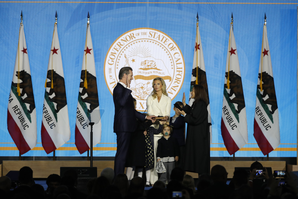 Gavin Newsom is sworn in as governor of California by California Chief Justice Tani Gorre Cantil-Sakauye as Newsom's wife, Jennifer Siebel Newsom, watches on January 7, 2019 in Sacramento, California.