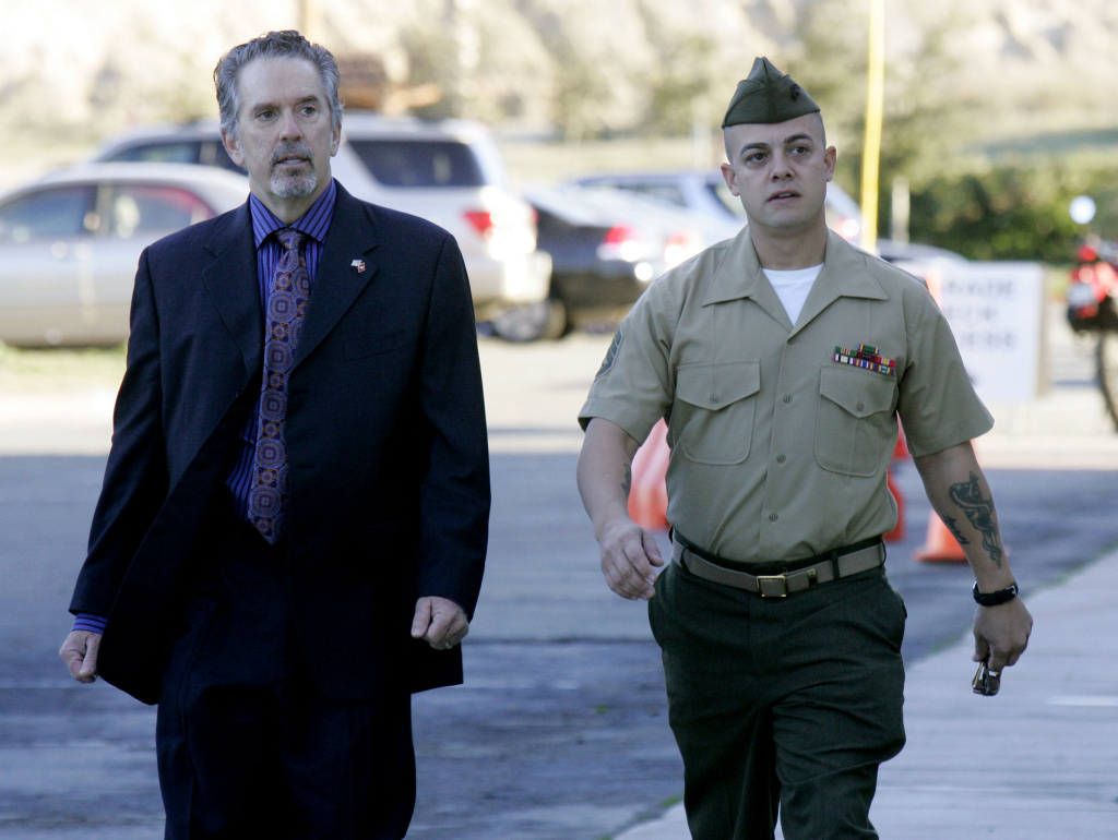 Staff Sgt. Frank Wuterich (R) walks into court with his defense attorney Neal Puckette during opening statements in the Haditha murders trial at Camp Pendleton on Jan., 9, 2012 in Oceanside, Calif. Staff Sgt. Wuterich was not sentenced with any jail time after orginally facing a possible life sentence.