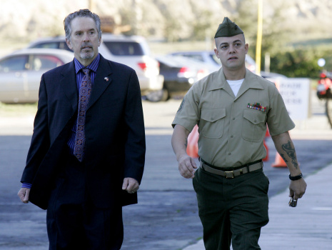 Staff Sgt. Frank Wuterich (R) walks into