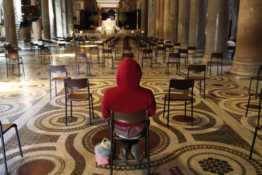 A faithful prays in the Church of Santa Maria in Trastevere where from Monday May 18 it will be possible to celebrate mass after more than two months of lockdown on May 15, 2020 in Rome, Italy.