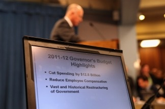 A laptop shows highlights of California Governor Jerry Brown's proposed budget during a press conference at the State Capitol on January 10, 2011 in Sacramento, California.