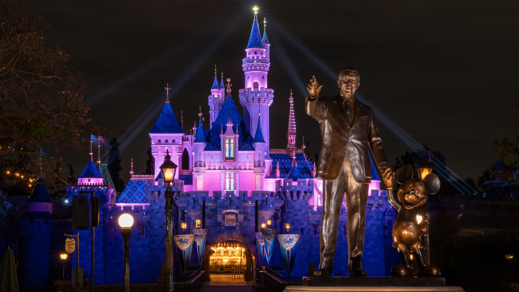 Disneyland's Sleeping Beauty Castle is lit up this week as the theme park prepares to reopen on Friday. California health restrictions allow the resort to operate at 25% capacity.
