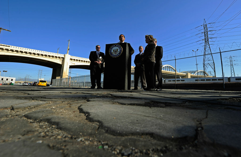 Los Angeles Mayor Antonio Villaraigosa speaks as U.S. Sen. Barbara Boxer (D-CA) and state and city officials listen on an industrial street with broken pavement at a news conference with with the Sixth Street bridge in the background on October 27, 2011 in Los Angeles, California.