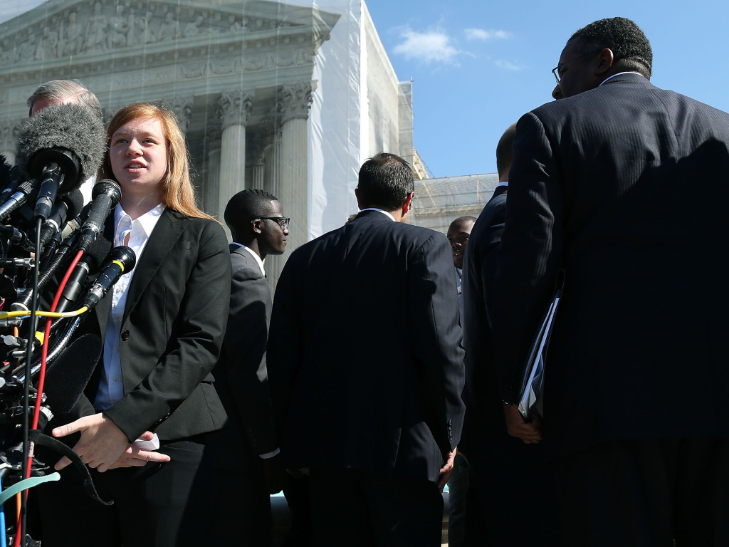 In this file photo, Abigail Noel Fisher, who challenged a racial component to University of Texas at Austin's admissions policy, speaks to the media outside the U.S. Supreme Court building during arguments in the case in October of 2013. In a 4-3 decision Thursday, the court decided that the university's