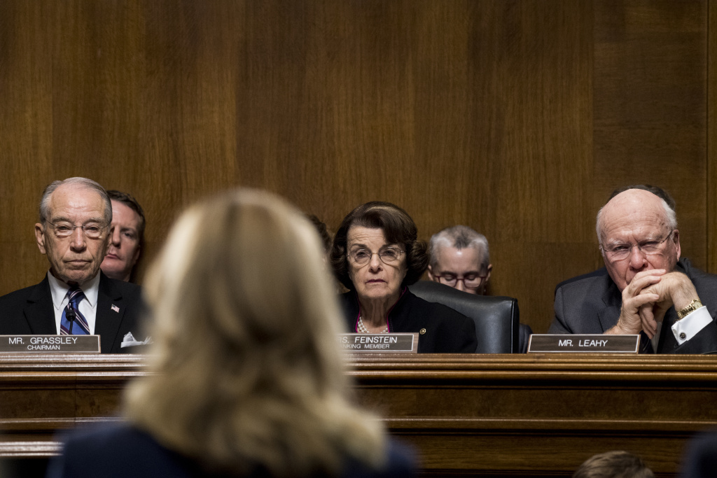 From left, Sen. Chuck Grassley, R-Iowa, Sen. Dianne Feinstein, D-Calif., and Sen. Patrick Leahy, D-Vt., listen as Dr. Christine Blasey Ford testifies during the Senate Judiciary Committee hearing on the nomination of Brett M. Kavanaugh to be an associate justice of the Supreme Court  on Capitol Hill September 27, 2018 in Washington, DC.