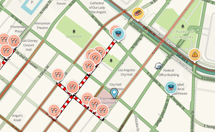 A screenshot of the Waze map of downtown Los Angeles, showing icons for road construction, police actions, traffic accidents and other information.