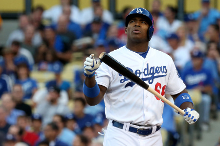 Yasiel Puig #66 of the Los Angeles Dodgers reacts while at bat in the second inning against the St. Louis Cardinals in Game Four of the National League Championship Series at Dodger Stadium on Oct. 15, 2013 in Los Angeles.