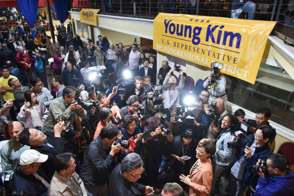 Republican Congressional candidate in California's 39th District Young Kim (R) is surrounded by supporters and media as she arrives at an election night event in Rowland Heights, California on November 6, 2018.